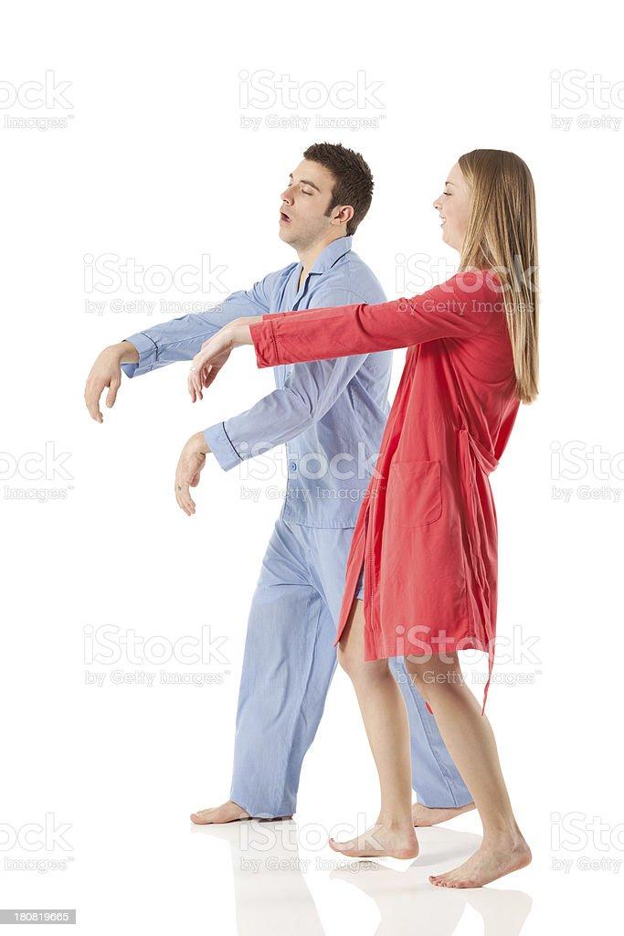 Young couple sleepwalking stock photo