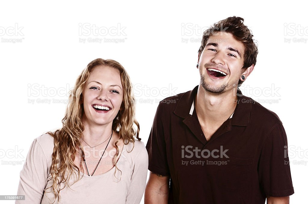 Young couple smiling and laughing togther: life is good stock photo