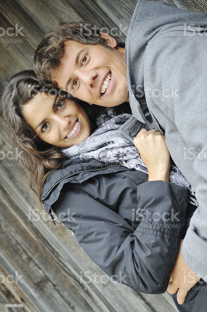 Young couple smiling in the cold royalty-free stock photo