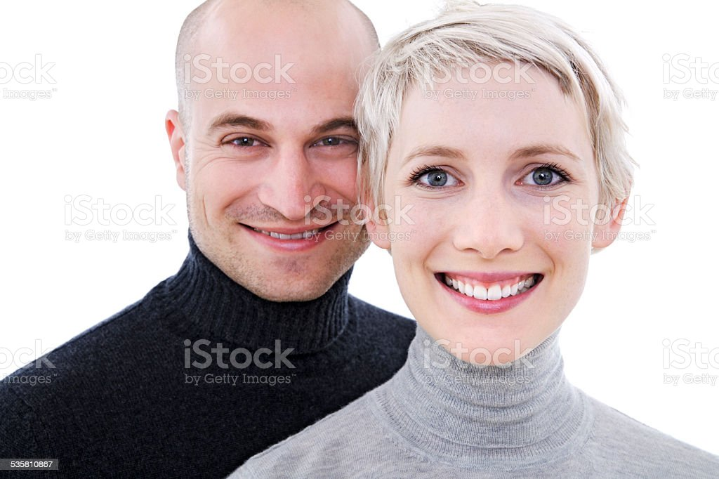 Young couple smiling, portrait stock photo
