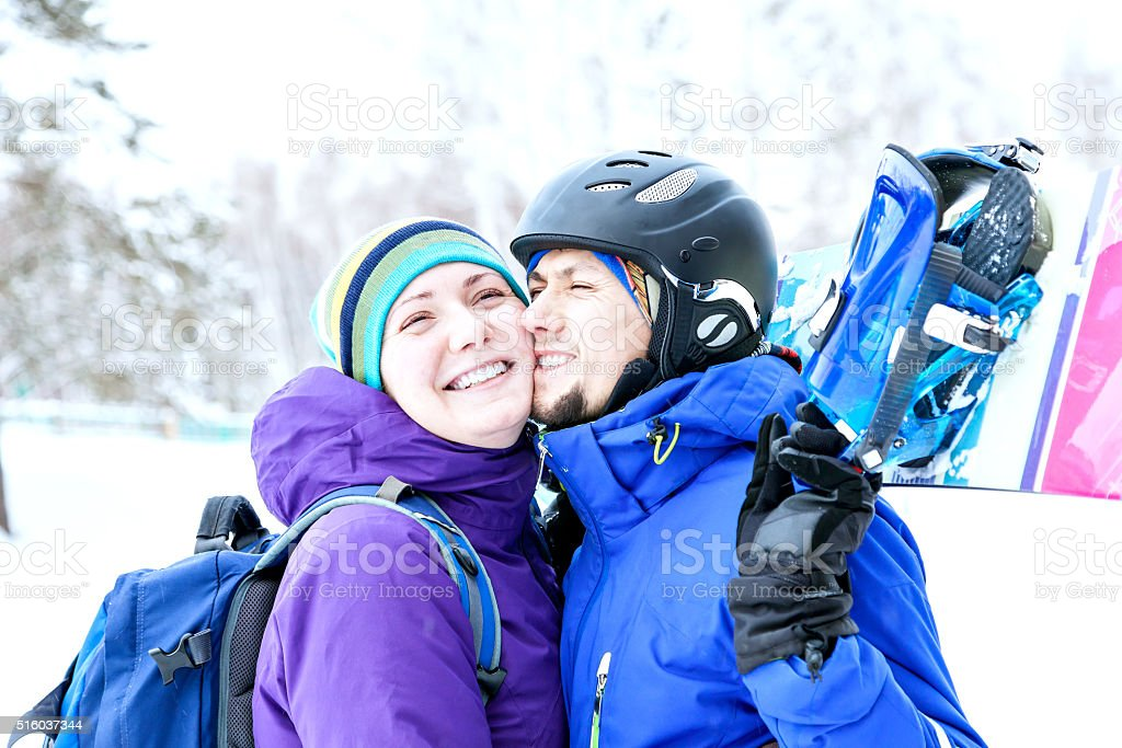young couple snowboarders rejoice and be glad stock photo