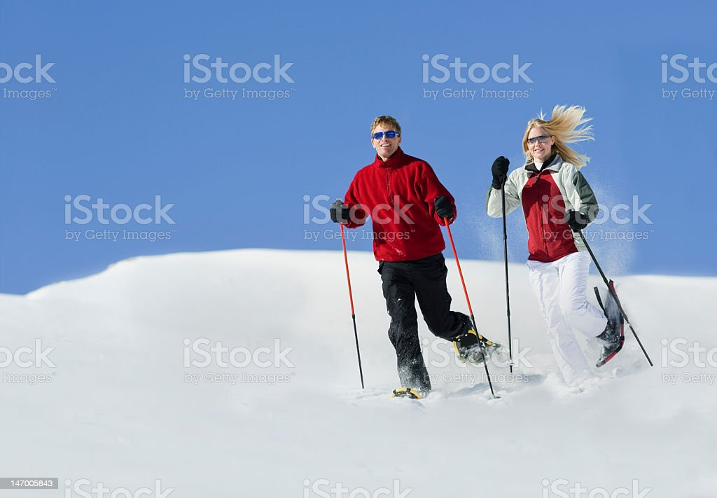 Young Couple Snowshoeing In Colorado royalty-free stock photo