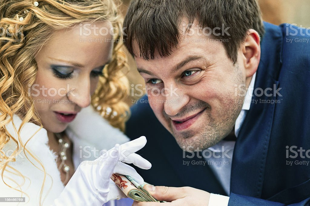 Young couple splits the money royalty-free stock photo