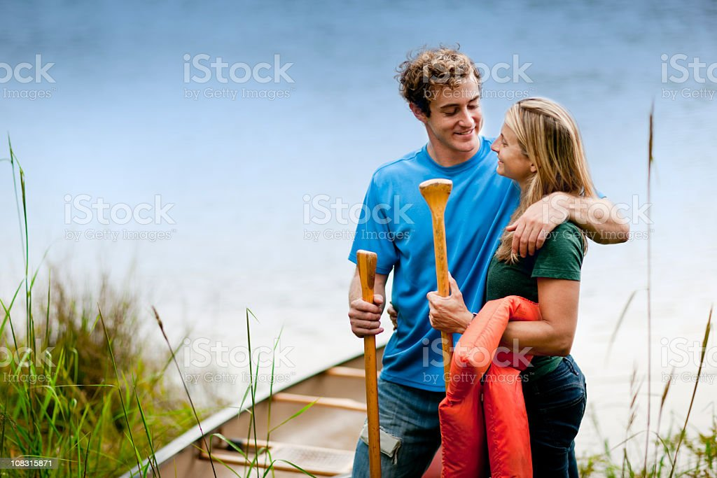Young Couple Stand Together by Lake royalty-free stock photo