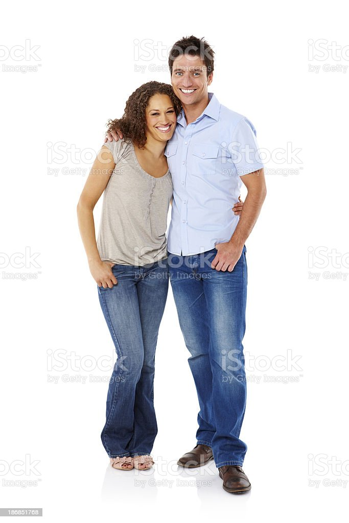 Young Couple Standing Affectionately - Isolated stock photo