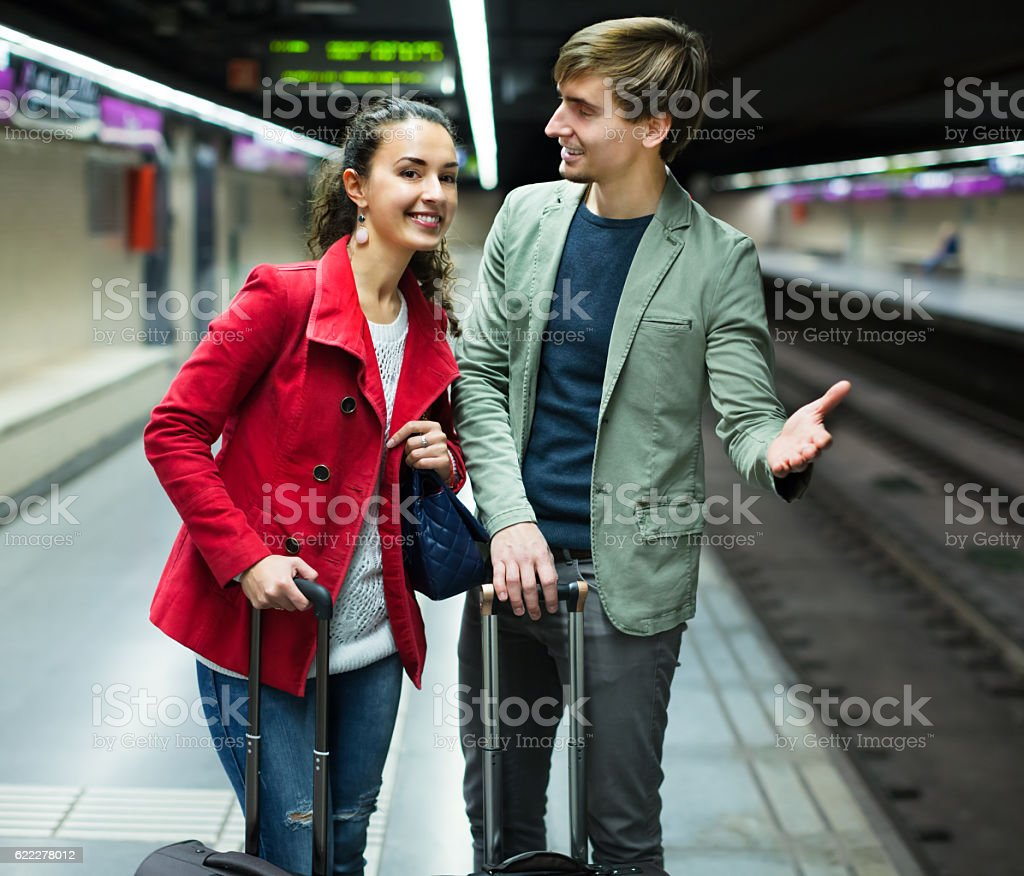 Young couple standing at underground station stock photo