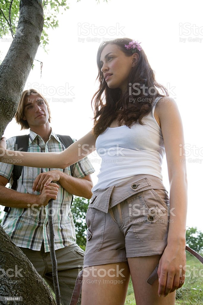 Young couple standing by a tree royalty-free stock photo