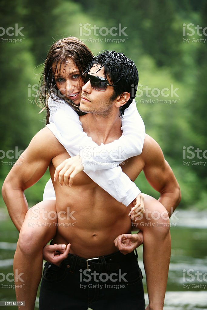 Young Couple Standing in a River royalty-free stock photo