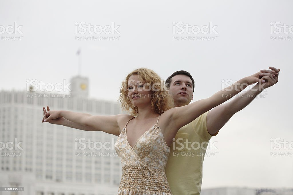 young couple standing in front of Russian White house stock photo