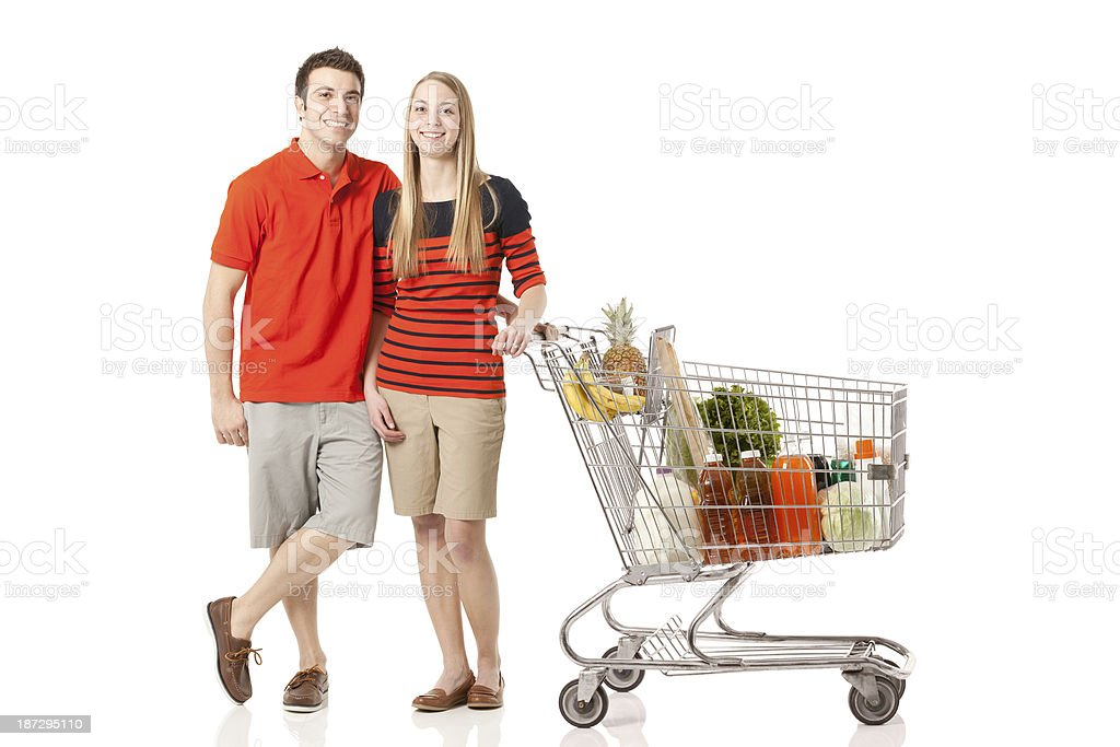 Young couple standing with shopping cart royalty-free stock photo