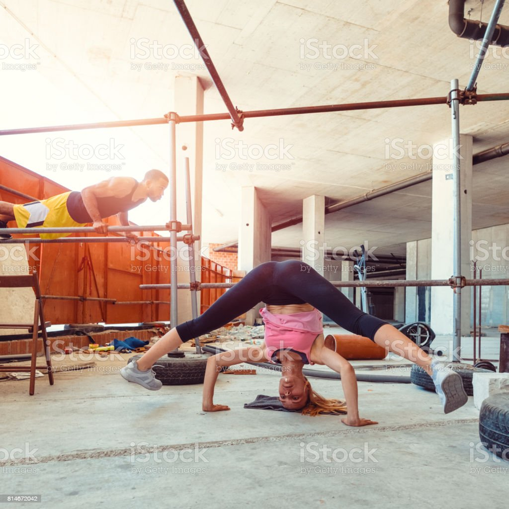 Young couple stretching in outdoor ghetto fitness stock photo