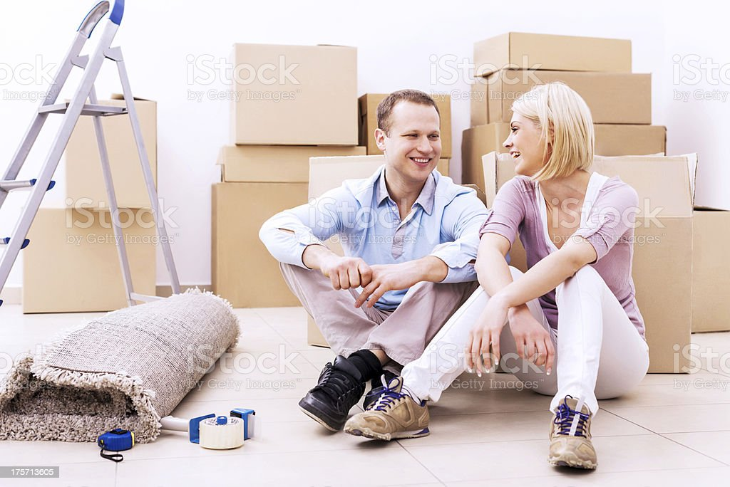 Young couple surrounded by cardboard boxes. royalty-free stock photo