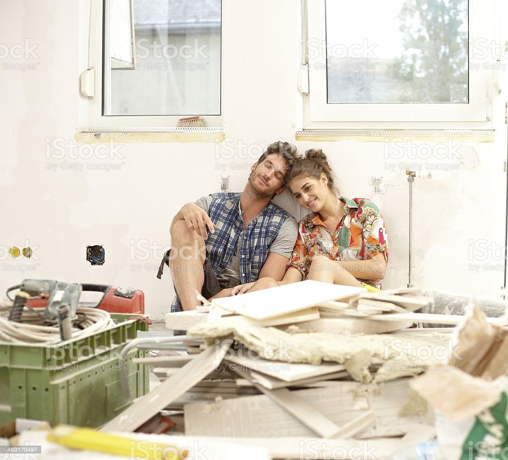 A young couple surrounded by DIY work tools stock photo