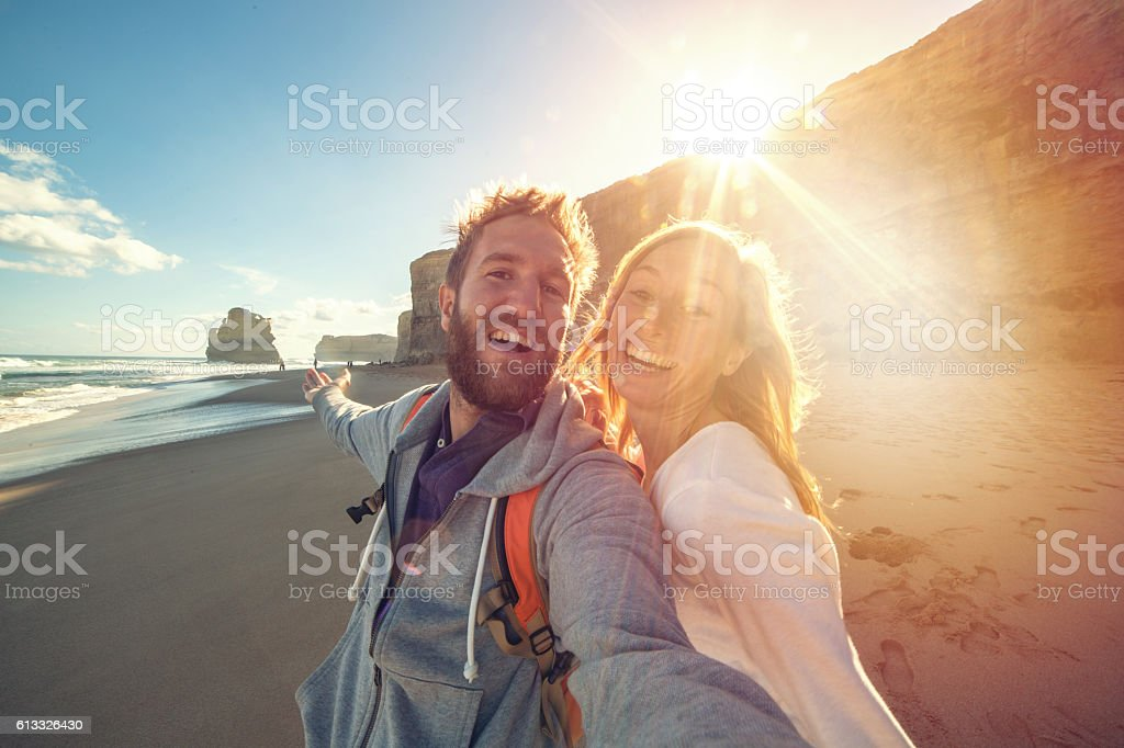 Young couple take a selfie portrait on Gibsons steps beach stock photo
