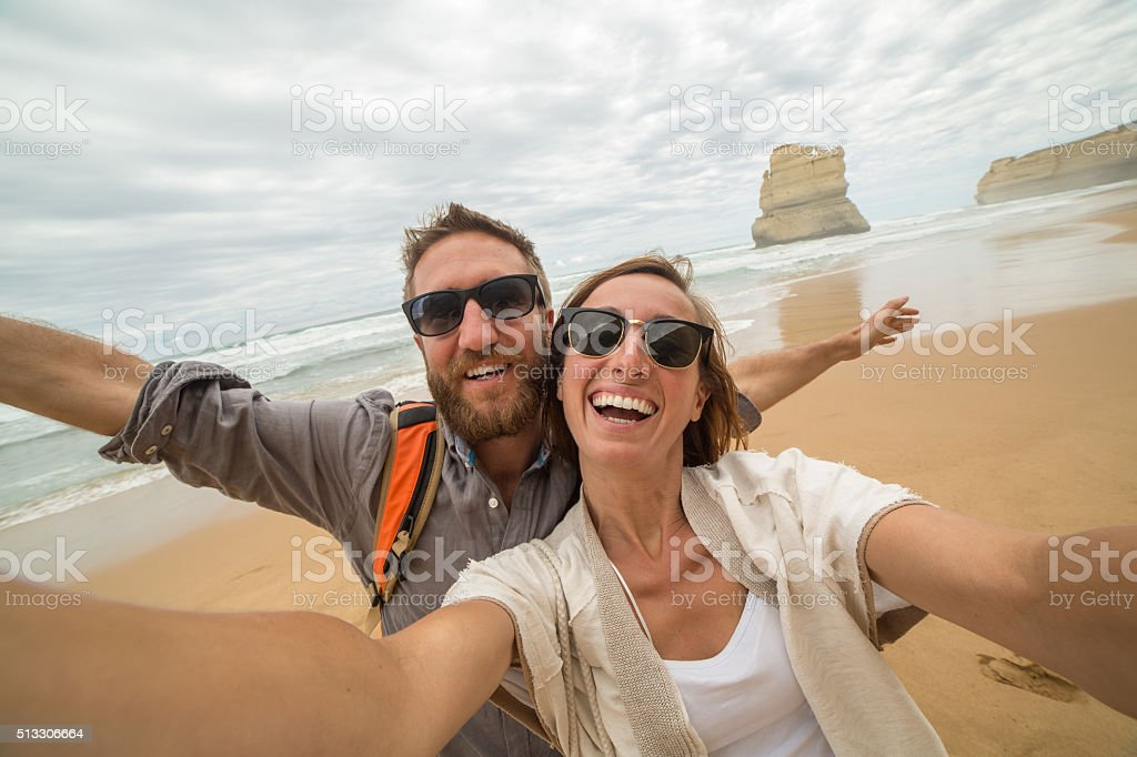 Young couple take selfie on Gibsons steps beach-Great ocean road stock photo