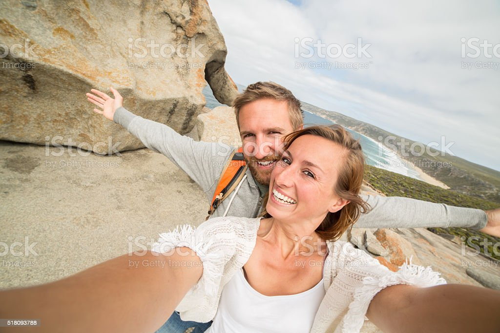 Young couple take selfie portrait at The Remarkable rocks-Australia stock photo