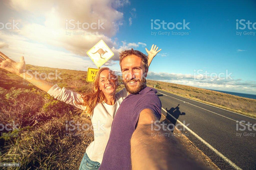 Young couple take selfie portrait in Australia, Kangaroo sign stock photo