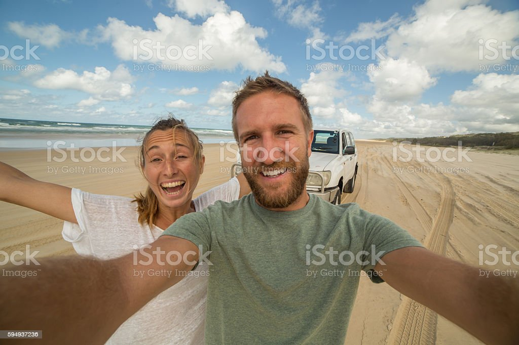 Young couple take selfie portrait with 4x4 on Fraser Island stock photo