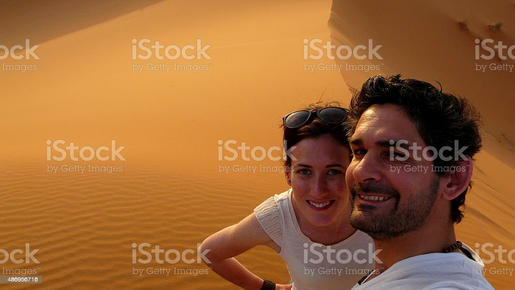 Young couple taking a self picture in the desert stock photo
