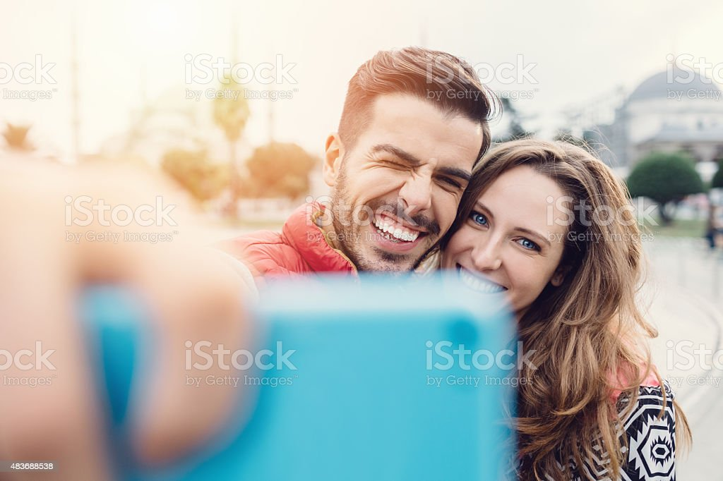 Young couple taking a selfie in Istanbul royalty-free stock photo