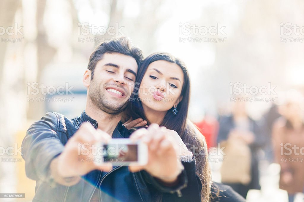 Young couple taking a selfie in las Ramblas Barcelona stock photo