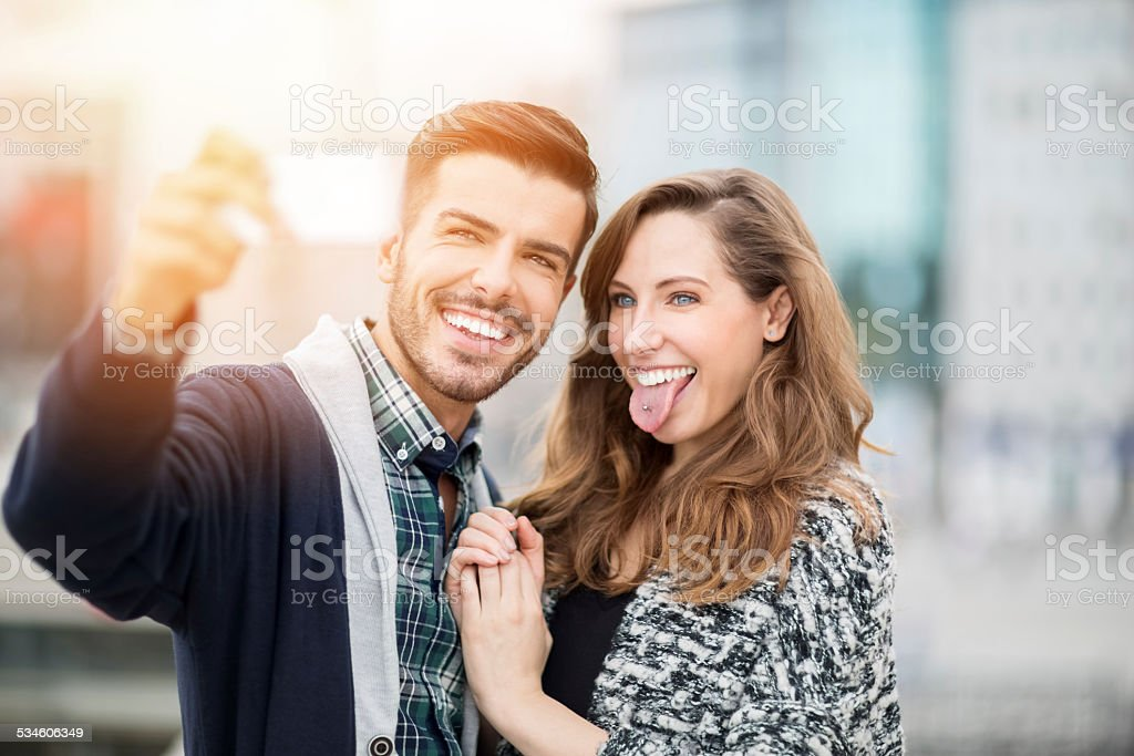 Young couple taking a selfie stock photo