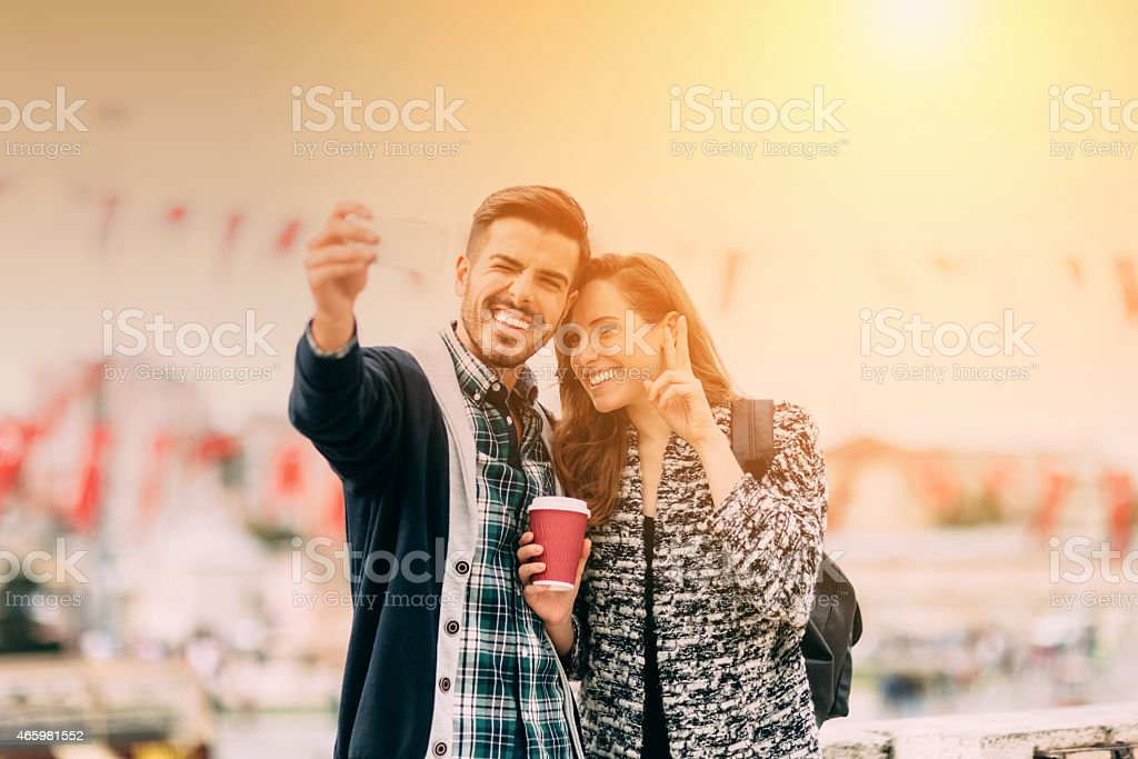 Young couple taking a selfie together stock photo
