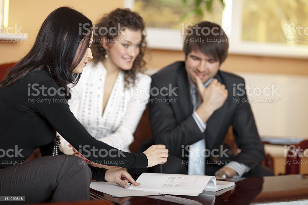 Young Couple Taking Mortgage Loan royalty-free stock photo