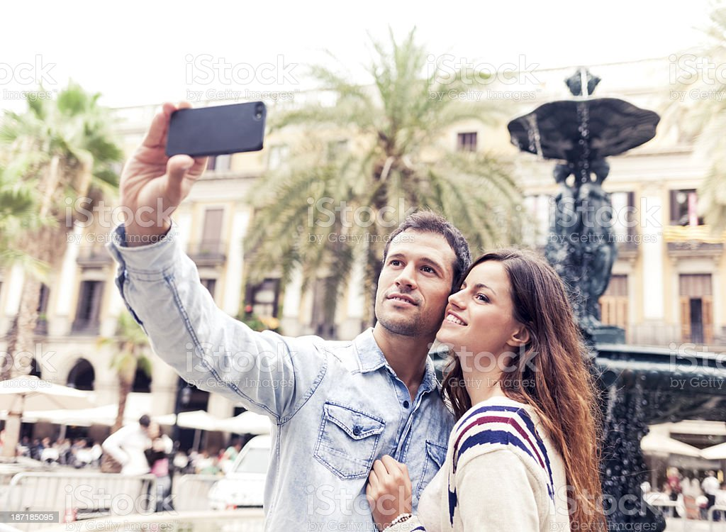 Young couple taking photo (Barcelona, Catalonia) stock photo
