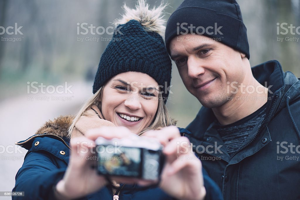 Young couple taking self portrait outdoor stock photo