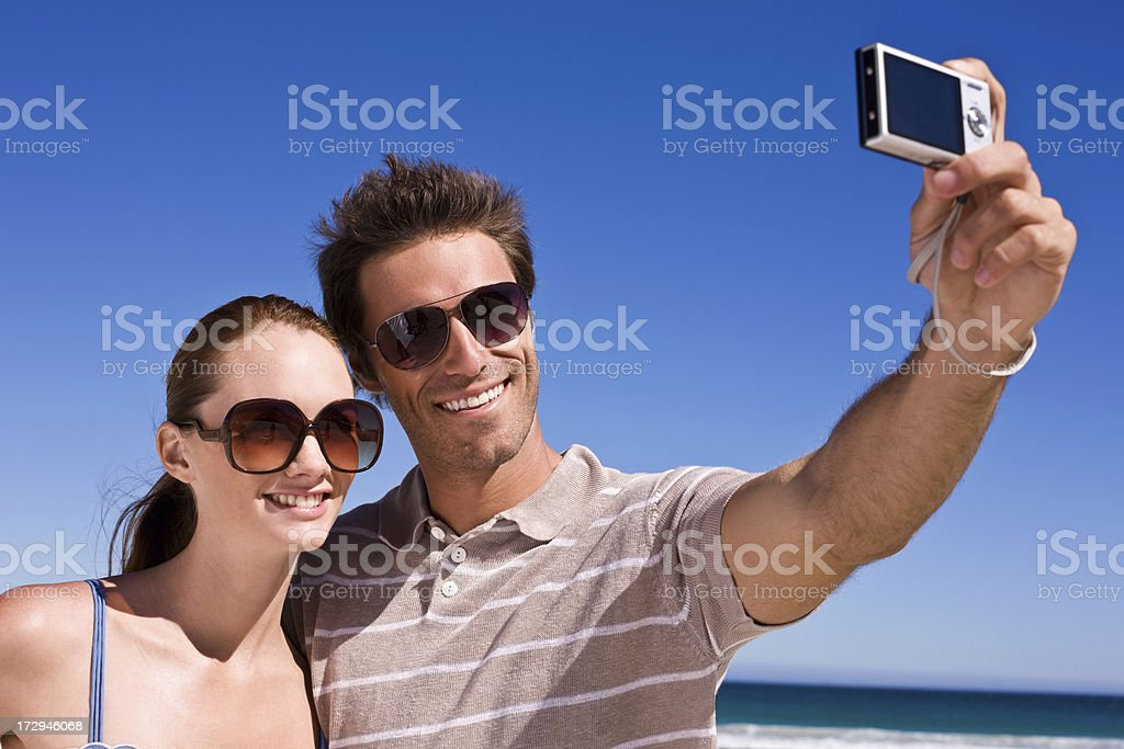 Young couple taking self portrait royalty-free stock photo