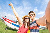 Young couple taking selfie at lightweight airplane travel