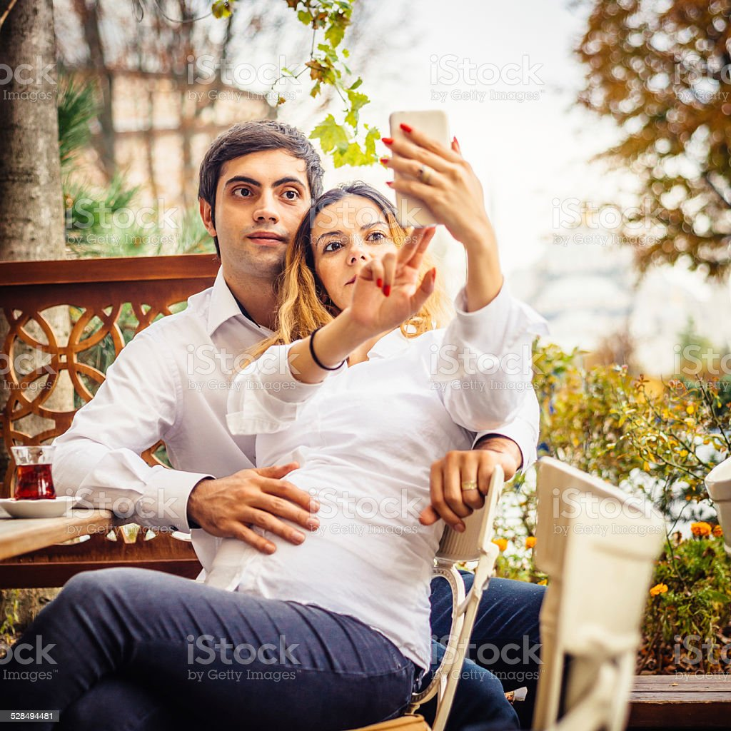 Young Couple Taking Selfie At The Cafe stock photo