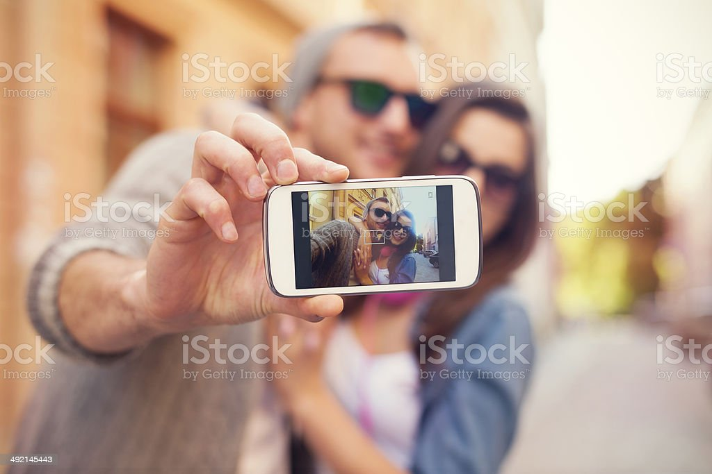 Young couple taking selfie in the city stock photo