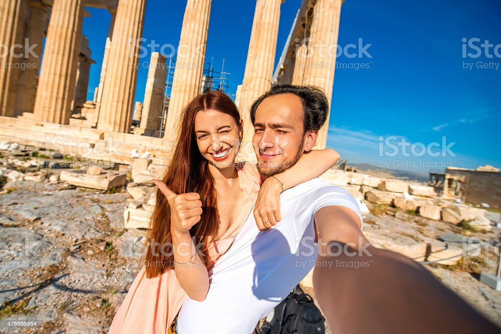 Young couple taking selfie picture with Parthenon temple on background stock photo