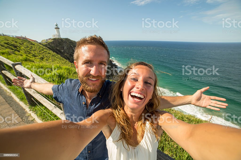Young couple taking selfie portrait on the east coast stock photo