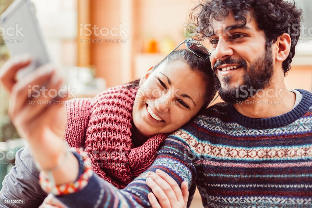 Young couple taking selfie together stock photo