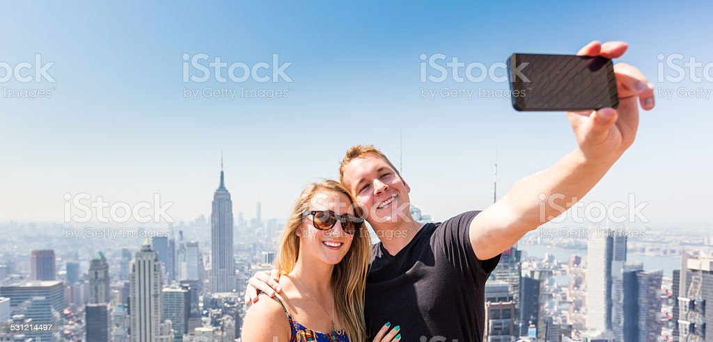 Young Couple Taking Selfie with New York on Background stock photo