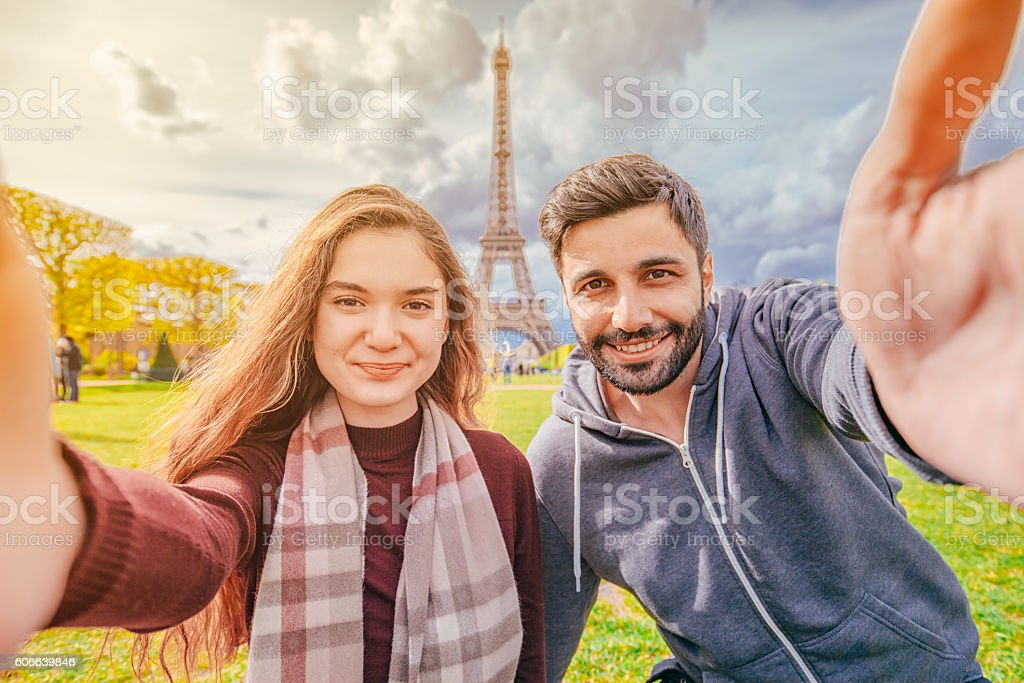 Young couple taking selfie with smartphone against Paris City stock photo
