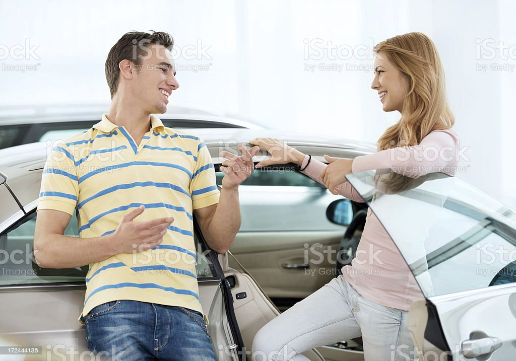 Young couple talking about a new car royalty-free stock photo