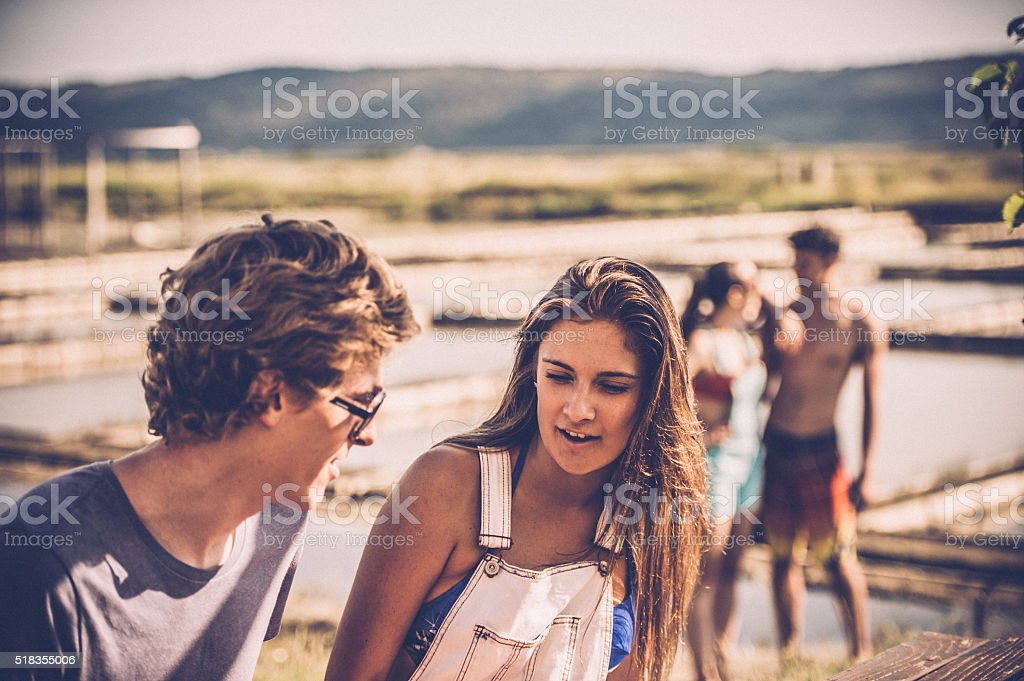 Young Couple Talking at Seaside stock photo