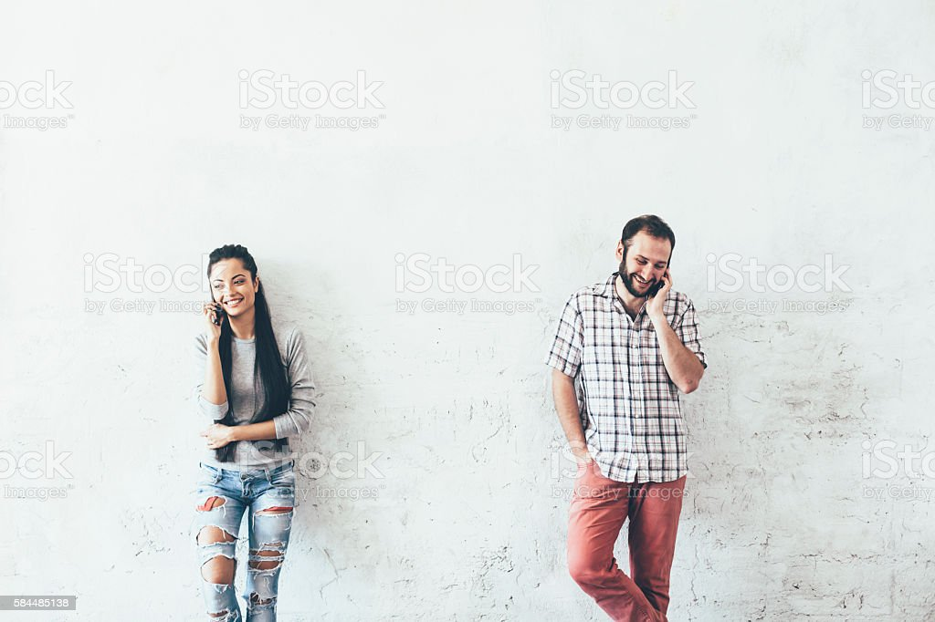 Young couple talking on the phone stock photo
