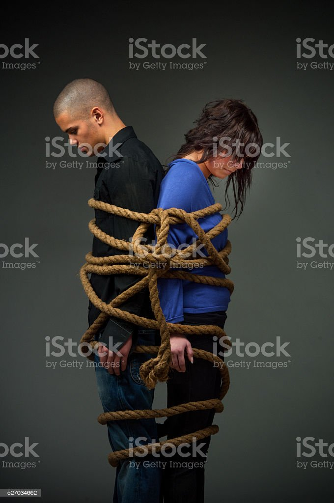 young couple tangled up.Relationship problems stock photo