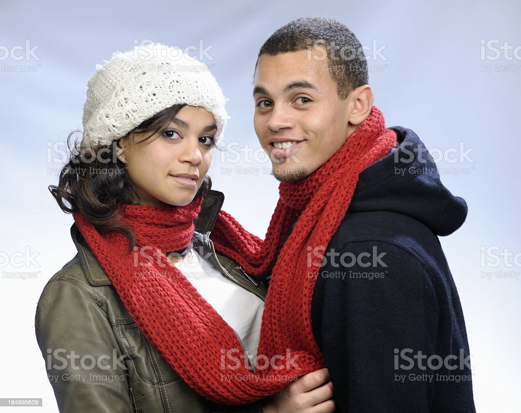 young couple tied up by red wool shawl royalty-free stock photo
