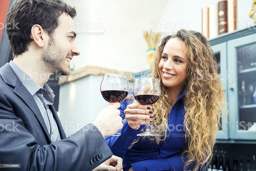 Young couple toasting at Happy Hour royalty-free stock photo
