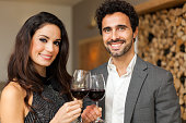 Young couple toasting wineglasses in a luxury restaurant