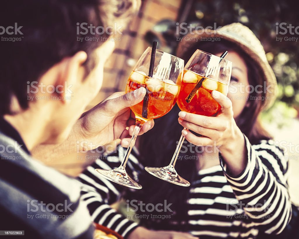Young Couple Toasting with Alcoholic Drinks stock photo