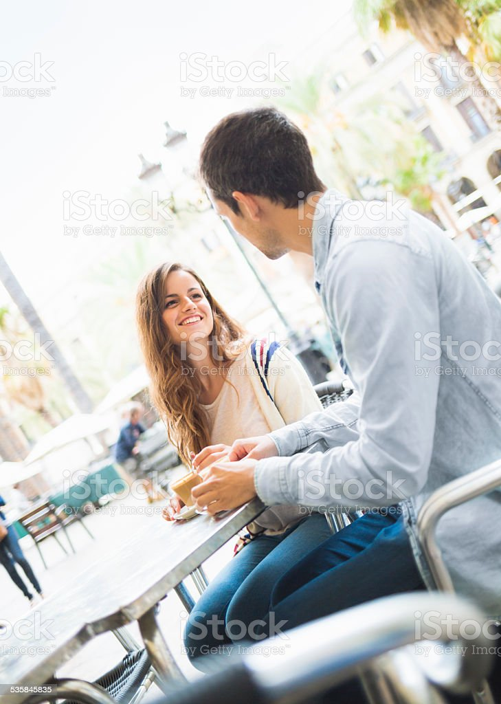 Young couple together in cafe in Barcelona, Spain. stock photo