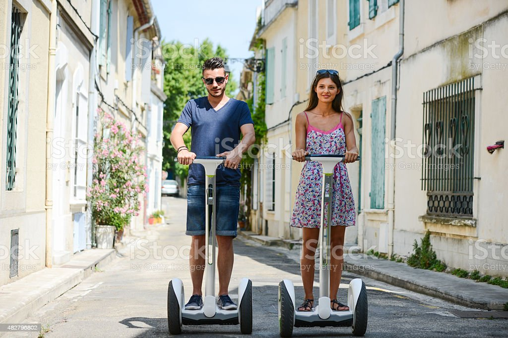 young couple tourist riding segway gyropode electric vehicle sightseeing tour stock photo
