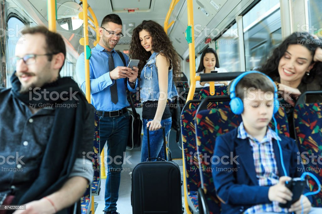 Young couple traveling and using smart phone stock photo